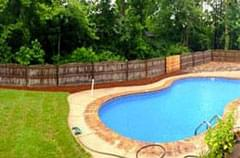 After: Fenced backyard with sparkling pool and green grass