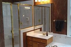 Before: Bathroom with builder-grade fixtures