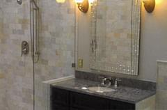 After: Bathroom with updated fixtures and modern color scheme