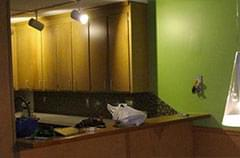 Before: Kitchen with outdated light and color combos