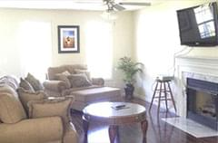After: comfortable living area with couches and lots of light