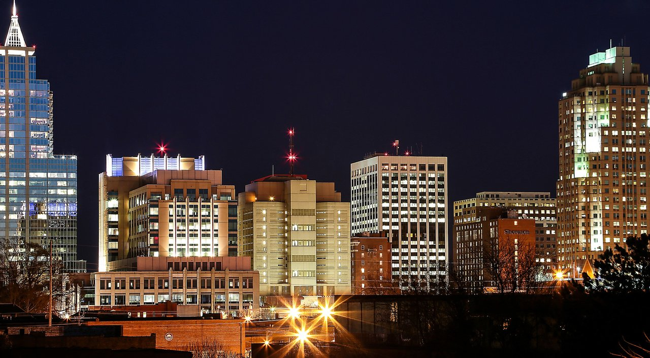 nighttime cityscape of Raleigh, NC